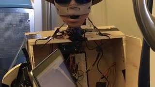 Robot with cowboy hat controlled by laptop subway - Video