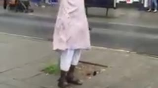 Man reciting Adhan in the street - UK - Video