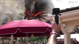 Dragon goes up in flames at Disney World Florida - Video