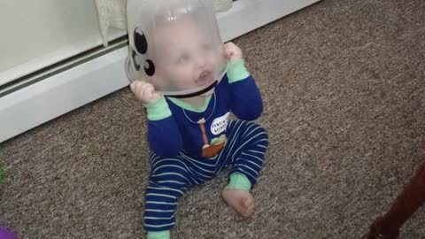 Baby hilariously puts toy bucket on head