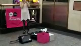 Music girl singing in front of mcdonalds subway - Video