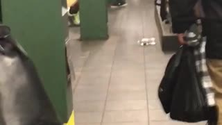 Shirtless black guy doing pushups on rail with black earphones on - Video