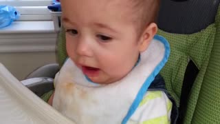 baby don't like his baby food. - Video