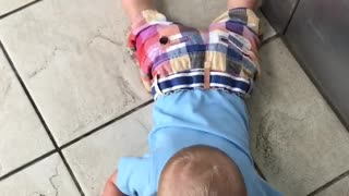 Tot Boy Drops To The Floor When Elevator Goes Down - Video