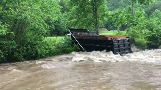 Brave Trucker Takes His Truck Over A Creek - Video