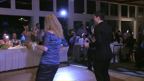 Mother and son entertain wedding guests
