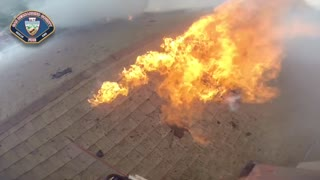 Helmet cam shows firefighters battling intense blaze - Video