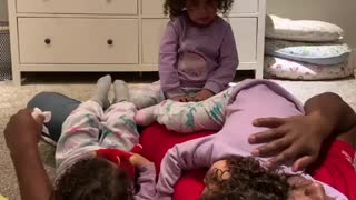 Little Girls Squabble Over Place To Cuddle With Daddy