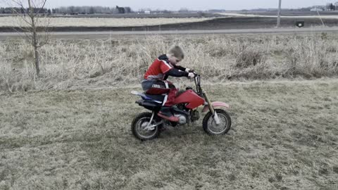 Kid trying to kickstart start dirt bike
