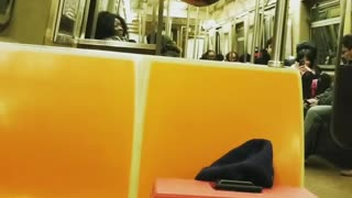 Green shirtless guy glasses hangs from subway railing - Video