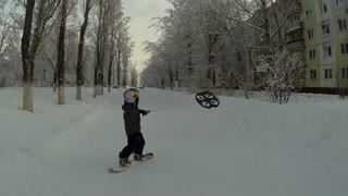 Snowboarding toddler uses flying drone to move around - Video