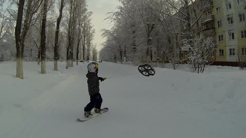 Snowboarding Toddler In Russia Uses Flying Drone To Move Around His Neighborhood