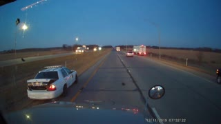 Squad Car Sent Spinning After Merging into Truck