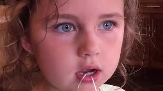 Slow motion kid tooth removal - Video
