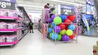 Guy climbs into ball bin at walmart