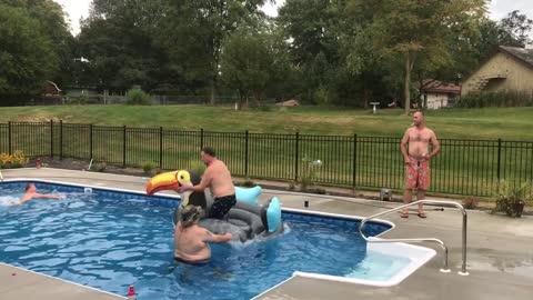 Man jumps into pool, kicks football, and flips over inflatable toucan floaty