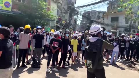 Riot police fire stun grenades and tear gas at protesters