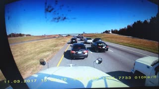 Car Spins Out of Control into Median - Video