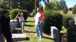 Bumbling Man Knocks Over Gravestone Trying To Plant Flowers