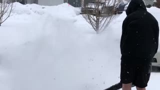Son Clears Snow in Shorts - Video