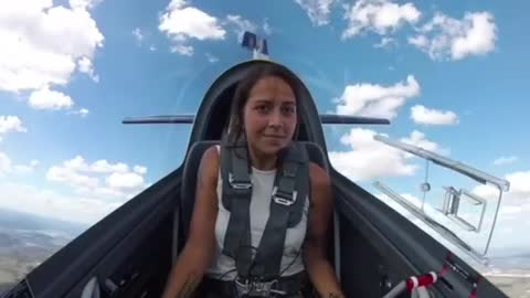 Female pilot flies a totally flat spin in the Extra 330LX stunt plane.