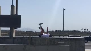 White shirt guy on back kicking and punching in air