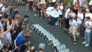 Guy skateboard jumps over beer kegs - Video
