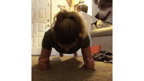 Dog refuses to let owner workout, wants to play instead
