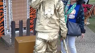 gold man in Baguio Philippines. - Video