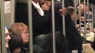 Guy helping other guy shave beard on subway