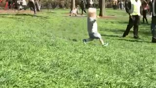 Blonde baby falls while running down hill - Video