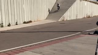 Guy on scooter goes down large ramp falls back