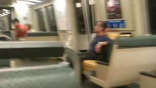 Person rides scooter through subway train speed lime