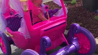 Girl In Princess Power Wheels Car Orders Toy At A Drive Thru - Video