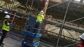 At work taking down the holy cross
