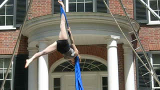 Woman performs aerial silks routine - Video