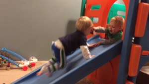 Toddler denies twin brother playpen access - Video