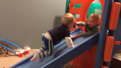 Toddler denies twin brother playpen access