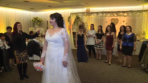Surprise marriage proposal during wedding bouquet toss