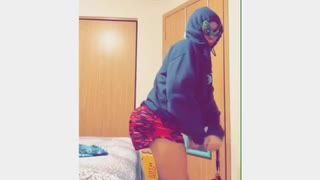 "Girl college student music video ""bubble butt"" hoodie, alien glasses, fake butt"