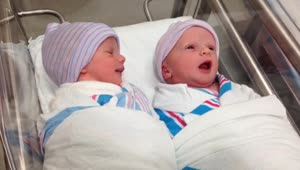 Newborn (one-hour-old) twins have first
