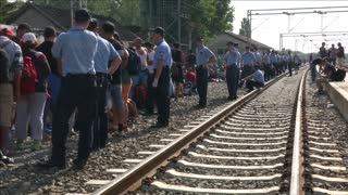 Migrants crowd into train station after entering Croatia