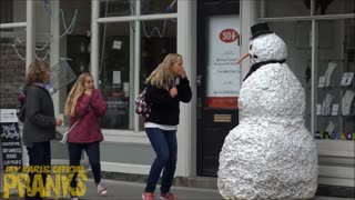 Haunted snowman scares unsuspecting victims - Video