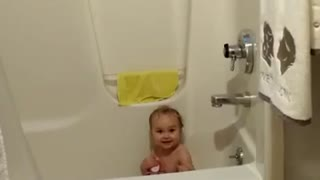 Little girl's precious response to being filmed - Video