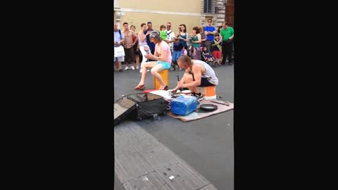 Street artist playing 'drums'