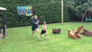 Mom bails into bushes after accepting race challenge from son - Video