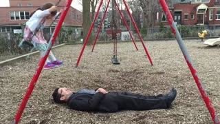Awesome dad perfects swing stunt at the park - Video