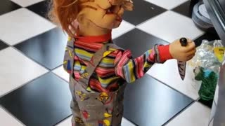 Scary Chucky Doll Rides Around On A Robot Vacuum