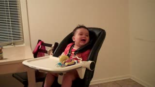 Baby laughs when mom jumps out from behind the fridge - Video