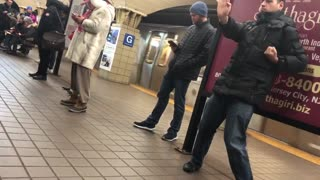 Guy practices his martial arts in subway station